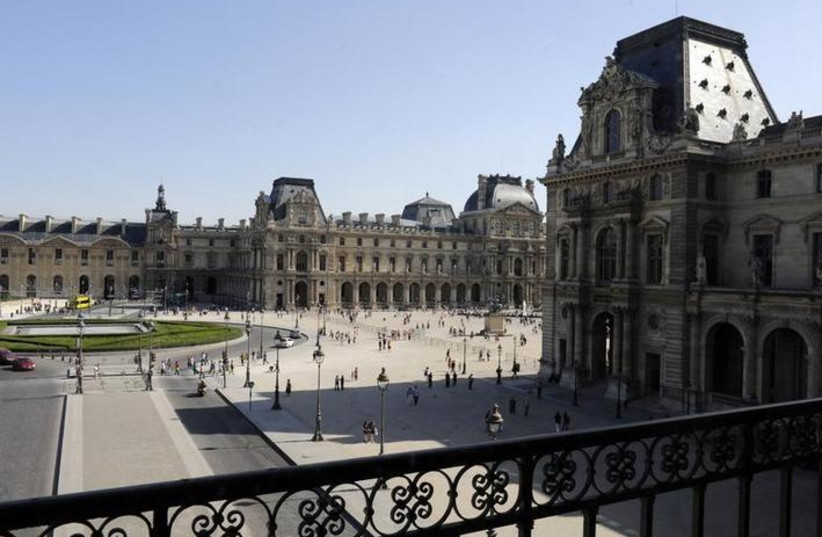 General view of the exterior of the Louvre Museum in Paris August 12, 2009. REUTERS/Jacky Naegelen (photo credit: REUTERS/JACKY NAEGELEN)