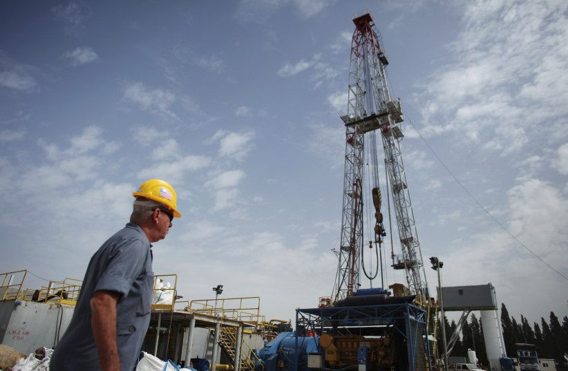 A worker walks near an oil rig belonging to Zion Oil and Gas in northern Israel in 2010. (photo credit: REUTERS/NIR ELIAS)