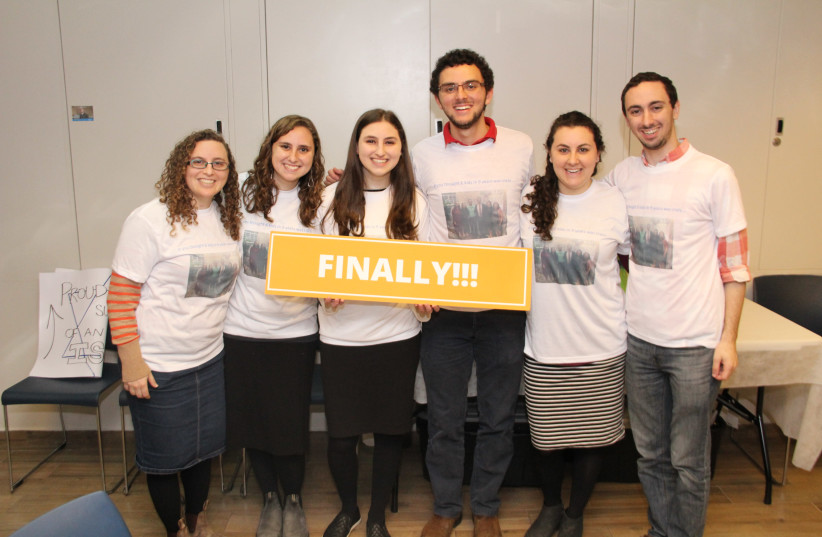 Akiva Gold and Elisheva Gold, center, pose for a photo with their siblings after making aliya on February 14th, 2018. (photo credit: COURTESY OF NEFESH B'NEFESH)
