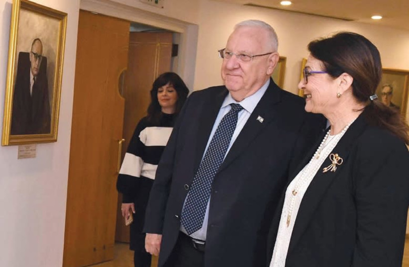 PRESIDENT REUVEN RIVLIN in the portrait gallery of the Supreme Court with Supreme Court President Esther Hayut (photo credit: MARK NEYMAN / GPO)