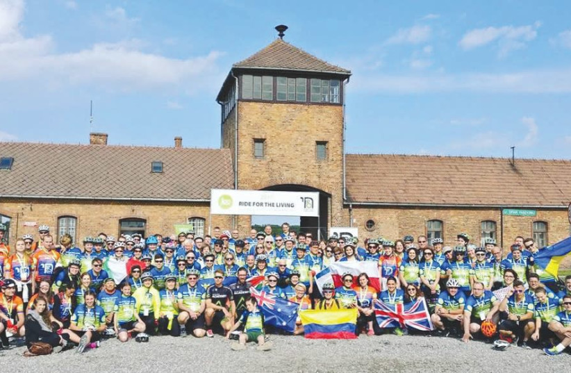 PEOPLE FROM across the globe take part in the JCC Krakow Ride for the Living in June 2017. The 88-km. ride starts at Auschwitz and ends in Krakow (photo credit: DAVID RUZHYNSKYI/FACEBOOK)