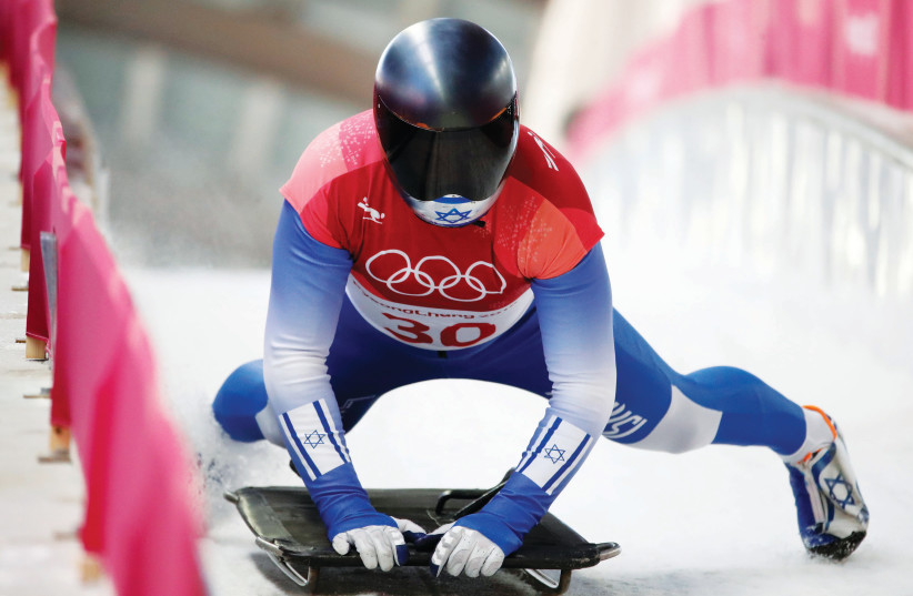 Israeli Olympian A.J. Edelman slides down the track during the Pyeongchang Winter Olympics in February, 2018. (photo credit: Courtesy)