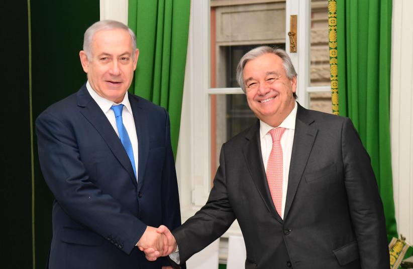 Prime Minister Benjamin Netanyahu meets United Nations Secretary-General in Munich, February 16, 2018 (photo credit: AMOS BEN GERSHOM, GPO)