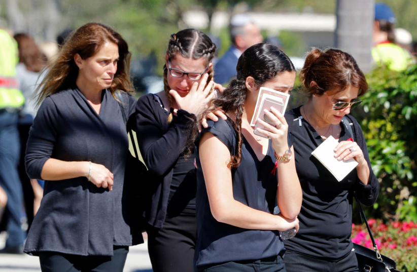 Mourners leave the funeral for Alyssa Alhadeff, 14, one of the victims of the school shooting, in North Fort Lauderdale, Florida, U.S., February 16, 2018 (photo credit: JOE SKIPPER/REUTERS)
