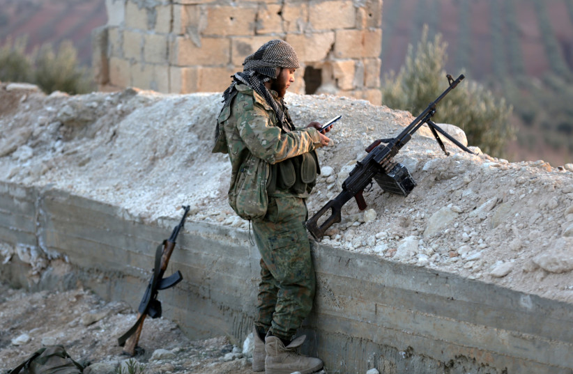 A Turkish-backed Free Syrian Army fighter in Afrin, Syria (photo credit: KHALIL ASHAWI / REUTERS)