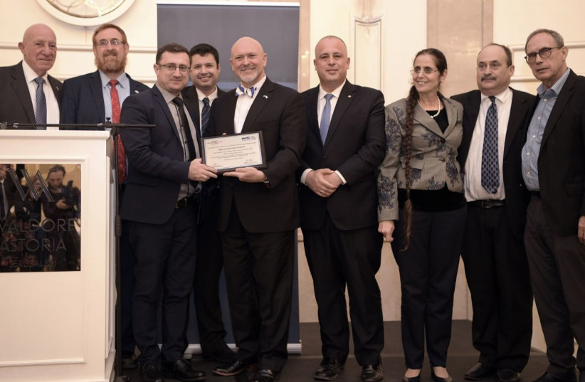 South Carolina State Rep. Alan Clemmons receives a lifetime achievement  award from the Knesset Christian Allies Caucus and World Jewish Congress. Pictured from left: Colonel Moshe Leshem, MK Yehudah Glick, MK Robert Ilatov, caucus director Josh Reinstein, Clemmons, MKs Hilik Bar and Anat Berko, WJC (photo credit: GIL HOFFMAN)