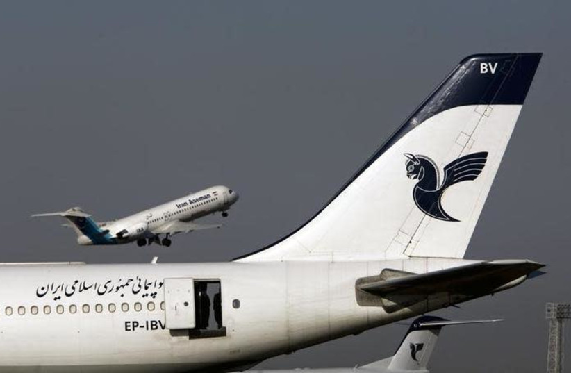 An Iranian Aseman Airlines' Fokker 100 takes off as an Iran Air aircraft is seen in the foreground at Tehran's international airport August 6, 2007.  (photo credit: REUTERS/MORTEZA NIKOUBAZL)