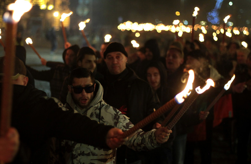 Members and supporters of several nationalist organizations take part in a march in commemoration of Bulgarian General Hristo Lukov in Sofia, Bulgaria, February 17, 2018 (photo credit: REUTERS/DIMITAR KYOSEMARLIEV)