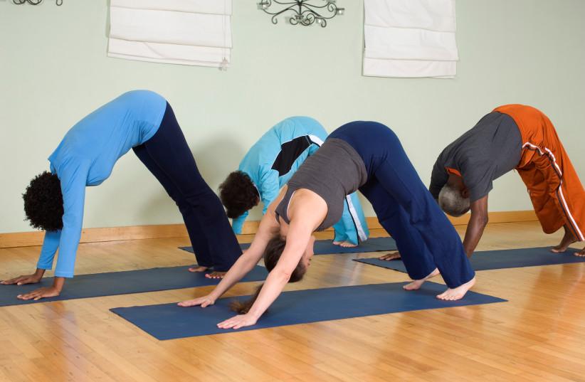 Yoga class (photo credit: INGIMAGE)