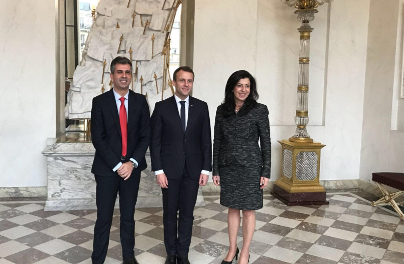 Economy Minister Eli Cohen (left) met with Palestinian counterpart Abeer Odeh (right) in Paris last week with French President Emmanuel Macron (center) to discuss steps to improve the Palestinian economy (photo credit: COURTESY ECONOMY MINISTRY)