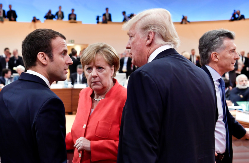 US President Donald Trump, German Chancellor Angela Merkel and French President Emmanuel Macron at the G-20 Summit in Hamburg, Germany, 2017 (photo credit: POOL)