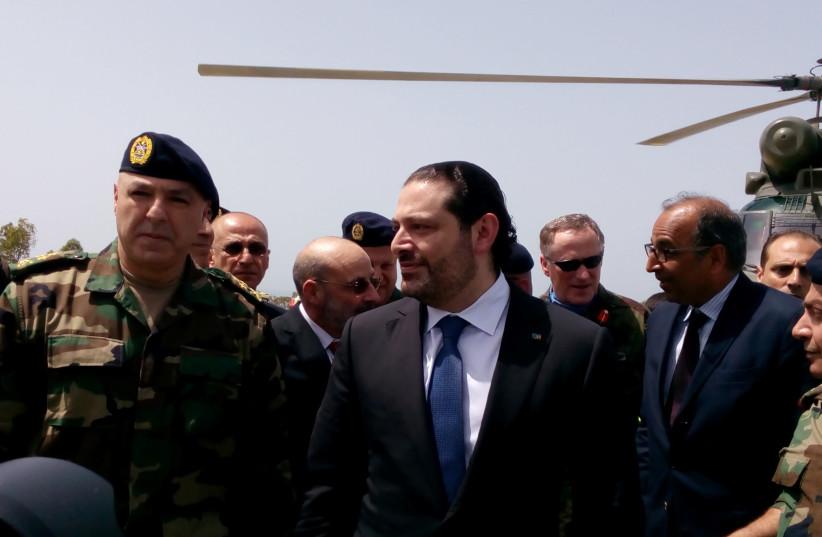 Lebanese Prime Minister Saad al-Hariri arrives with Army Commander General Joseph Aoun (L) at the United Nations Interim Force in Lebanon (UNIFIL) headquarters (photo credit: REUTERS/ALI HASHISHO)