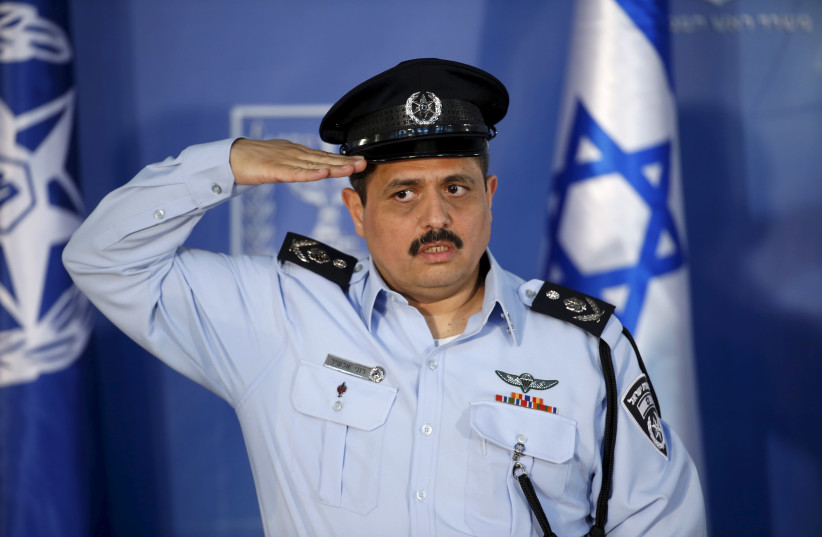 Police commissioner Roni Alsheich salutes during a ceremony (photo credit: BAZ RATNER/REUTERS)