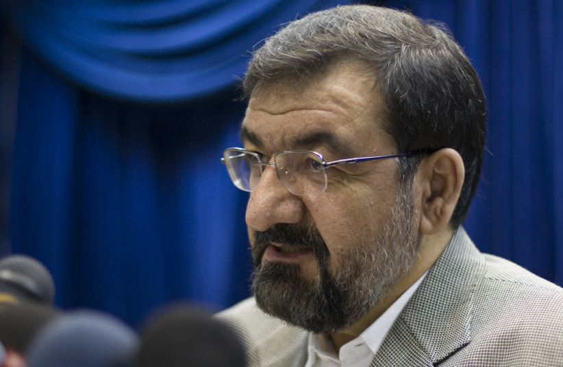 Iranian secretary of the Expediency Council arbitration body Mohsen Rezaei speaks during a news conference in Tehran (photo credit: REUTERS/RAHEB HOMAVANDI)