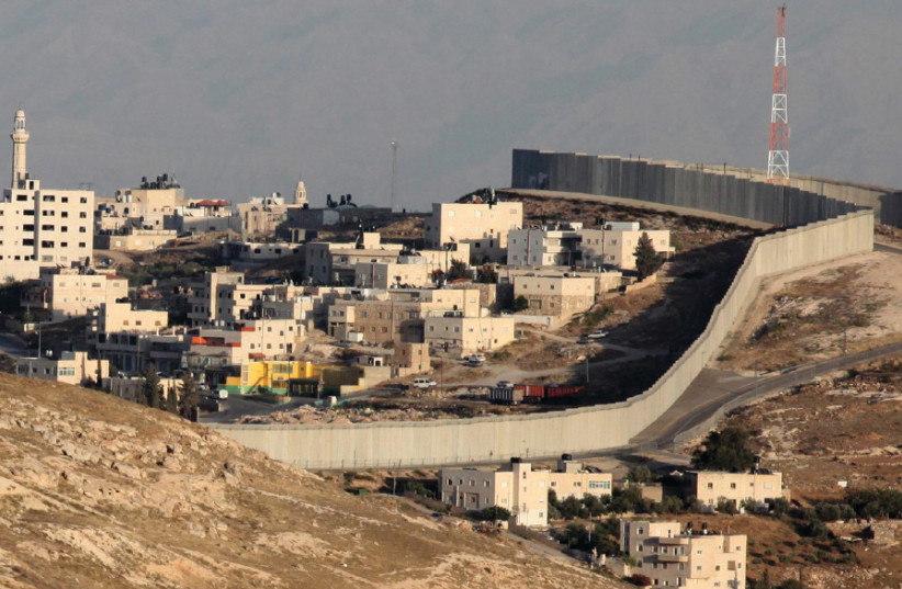 The east Jerusalem neighborhood of Abu Dis and the security barrier that separates it from the rest of the city (photo credit: MARC ISRAEL SELLEM)