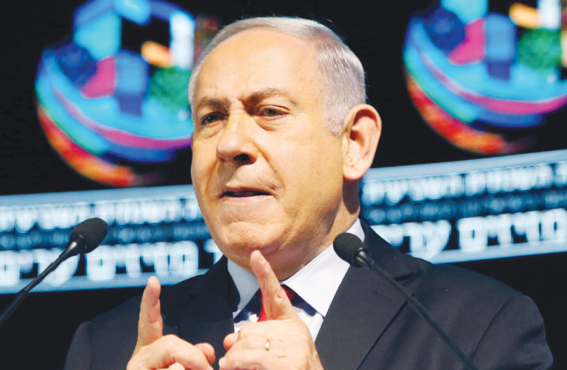 Prime Minister Benjamin Netanyahu addresses a conference in Tel Aviv on February 14 (photo credit: REUTERS/NIR ELIAS)