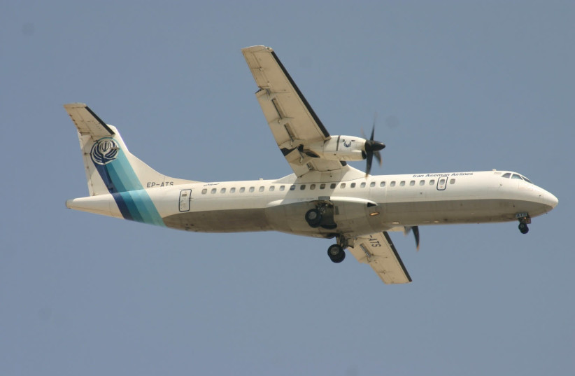 A twin-engined turboprop ATR-72 Aseman Airlines plane, that crashed in central Iran is seen in Dubai, United Arab Emirates (photo credit: COURTESY OF DAVID OSBORN/AEROPRINTS /VIA REUTERS)