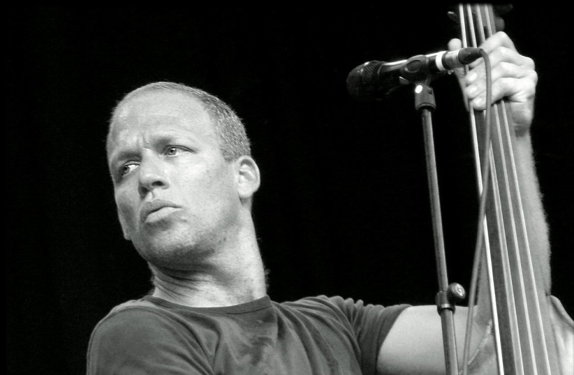 Israeli jazz bassist Avishai Cohen  (photo credit: GAUTHIER VANDEMOORTELE / WIKIMEDIA COMMONS)