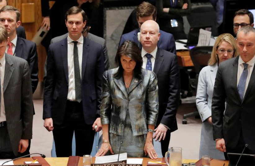 U.S. United Nations ambassador Nikki Haley (C) White House senior adviser Jared Kushner (L) and Jason Greenblatt (R), U.S. President Donald Trump's Middle East envoy, stand before the start of a Security Council meeting on the situation in the Middle East at the United Nations in New York, U.S., Feb (photo credit: LUCAS JACKSON/REUTERS)
