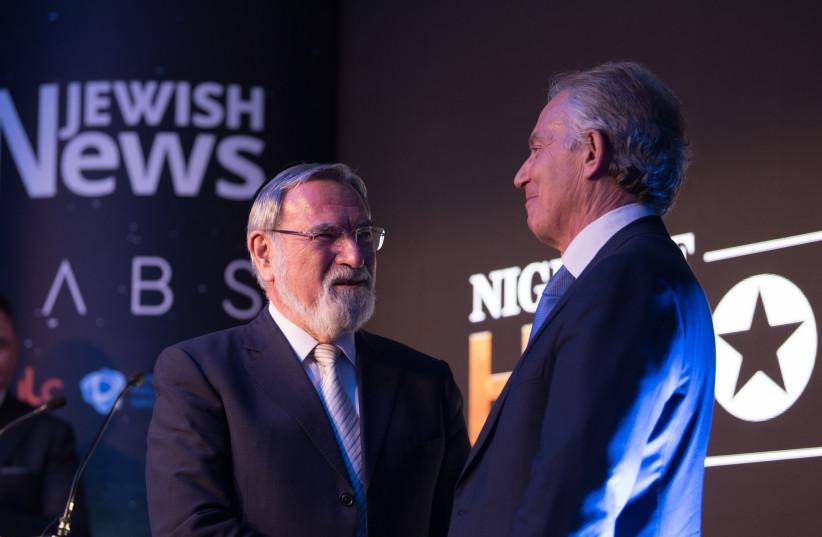 Former prime minister Tony Blair presents Lord Rabbi Jonathan Sacks with a Lifetime Achievement award at the Jewish News' Night of Heroes (photo credit: BLAKE EZRA PHOTOGRAPHY)