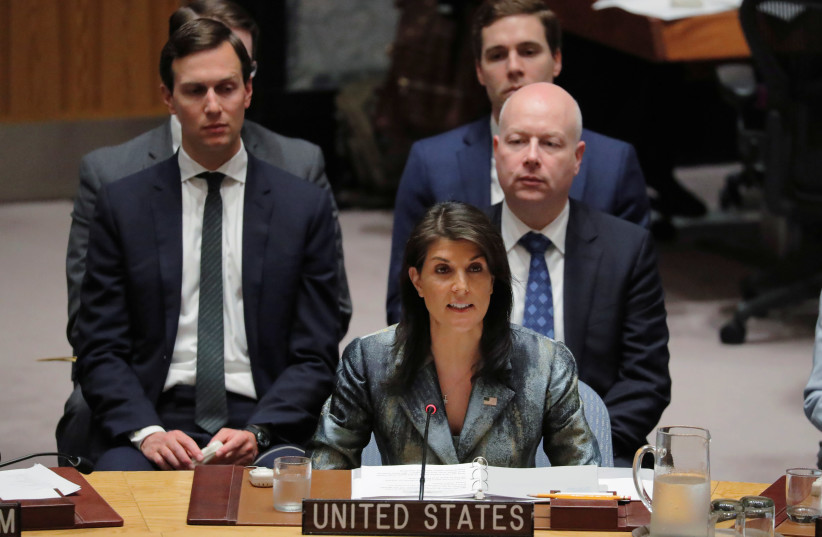 United States Ambassador to the United Nations (UN) Nikki Haley speaks in front of White House senior adviser Jared Kushner during a meeting of the UN Security Council at UN headquarters in New York, U.S., February 20, 2018.  (photo credit: REUTERS)