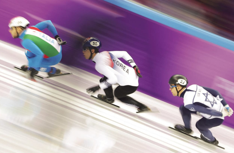 VLADISLAV BYKANOV (right) of Israel finished cleanly in his 500-meter heat in the short-track speedskating event at the Winter Olympics in Pyeongchang, albeit in last place with a time of 47.177 seconds (photo credit: REUTERS)