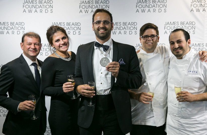 Alon Shaya (center) celebrates his win at the James Beard Awards ceremony in Chicago in 2016 (photo credit: GALDONES PHOTOGRAPHY/JAMES BEARD FOUNDATION)