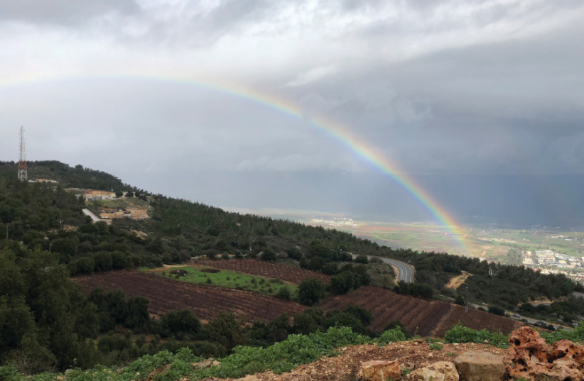 A RAINBOW stretches over Kibbutz Misgav Am in the Upper Galilee (photo credit: JOHN T. HUDDY/THE MEDIA LINE)