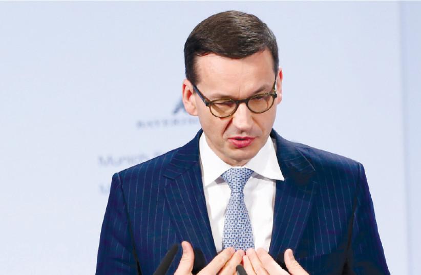 POLAND'S PRIME Minister Mateusz Morawiecki (photo credit: REUTERS/MICHAELA REHLE)