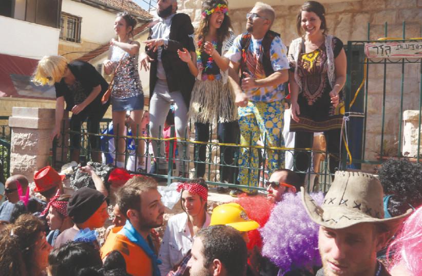 Purim revelers in the Nahlaot neighborhood (photo credit: MARC ISRAEL SELLEM)
