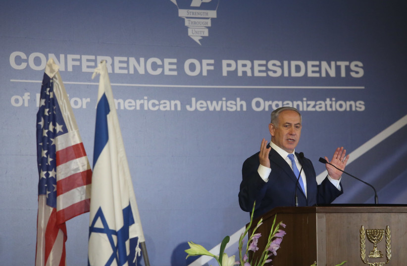 Prime Minister Benjamin Netanyahu speaking at the Conference of Presidents of Major American Jewish Organizations, February 21, 2018 (Marc Israel Sellem/The Jerusalem Post) (photo credit: MARC ISRAEL SELLEM/THE JERUSALEM POST)