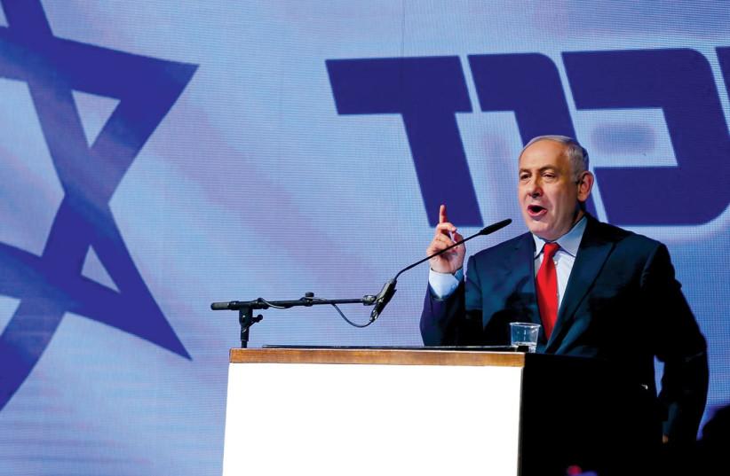 PRIME MINISTER Benjamin Netanyahu at a Likud party meeting last year. (Reuters) (photo credit: REUTERS)