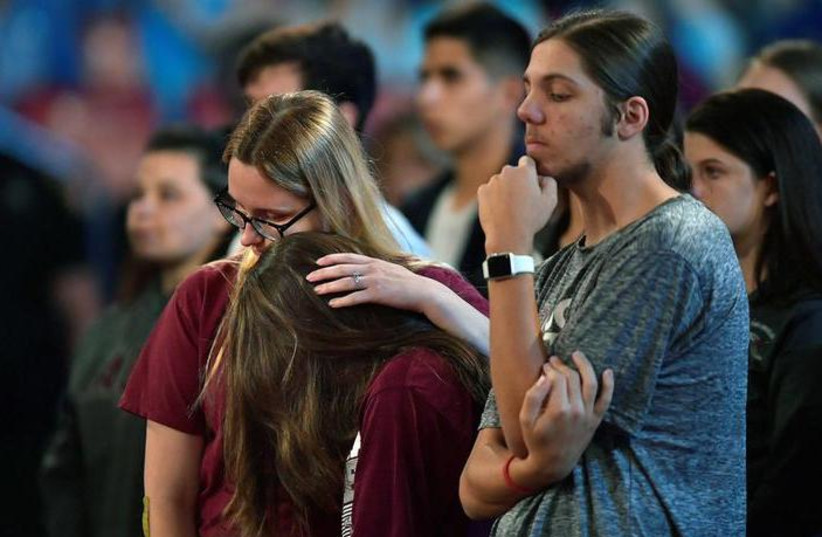 Marjory Stoneman Douglas High School students listen to sheriff Scott Israel speak before a CNN town hall meeting at the BB&T Center, in Sunrise, Florida, US February 21, 2018. (photo credit: REUTERS/MICHAEL LAUGHLIN/POOL)
