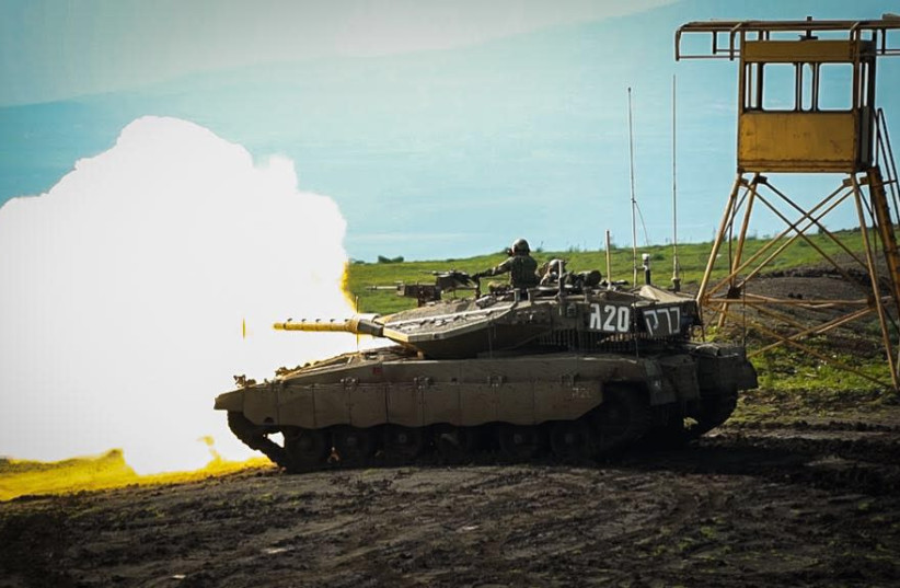 An IDF tank fires during a military exercise near the northern border on February 22, 2018. (photo credit: IDF SPOKESPERSON'S OFFICE)