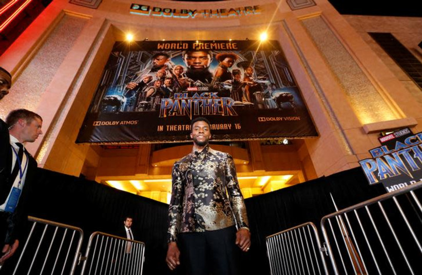 """Cast member Chadwick Boseman poses at the premiere of """"Black Panther"""" in Los Angeles, California, US, January 29, 2018. (photo credit: MARIO ANZUONI/REUTERS)"""