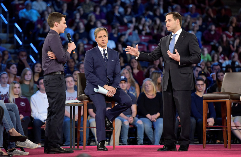 Marjory Stoneman Douglas student Cameron Kasky asks Senator Marco Rubio if he will continue to accept money from the NRA (photo credit: REUTERS/MICHAEL LAUGHLIN/POOL)