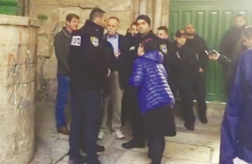 Police detain congressmen Scott Tipton (left) and David McKinley (3rd left) on the Temple Mount yesterday (photo credit: PROCLAIMING JUSTICE TO THE NATIONS)