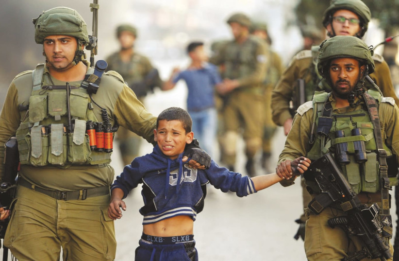 Amnesty report claims Israel 'kills,' 'tortures' Palestinian ...