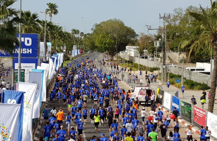 Runners at Tel Aviv's annual marathon, February 23, 2018 (Magen David Adom spokesperson) (photo credit: MAGEN DAVID ADOM)