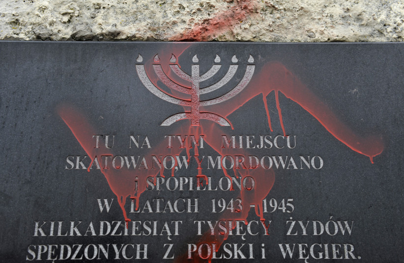 Antisemitic graffiti is seen on a monument dedicated to the victims of the Krakow ghetto, 2010. (photo credit: REUTERS / PAWEL ULATOWSKI)