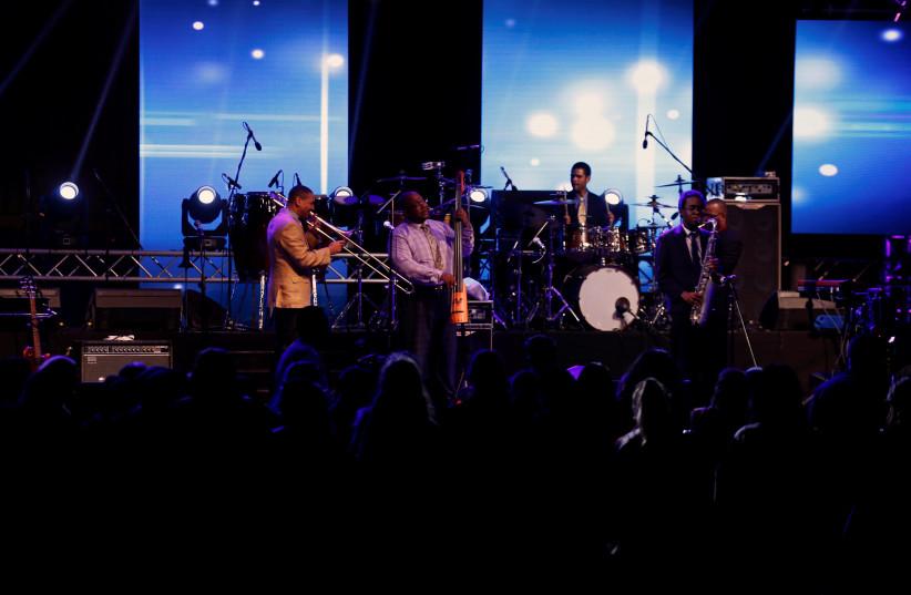 A band performs during the jazz festival in Riyadh, Saudi Arabia February 23, 2018.  (photo credit: FAISAL AL NASSER/ REUTERS)