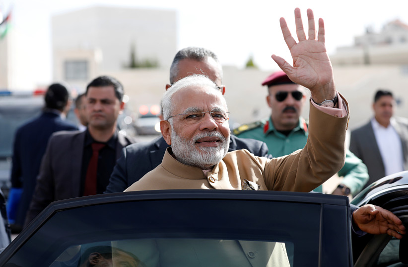 India's Prime Minister Narendra Modi waves upon his arrival to meet with Palestinian President Mahmoud Abbas (not pictured) in Ramallah, in the West Bank February 10, 2018. (photo credit: REUTERS/MOHAMAD TOROKMAN)