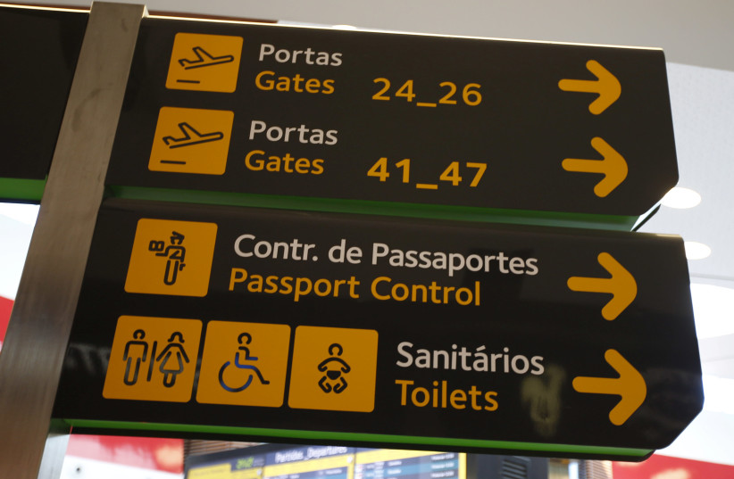 Gates, passport control and toilets signs are seen at Lisbon's airport, Portugal June 24, 2016.  (photo credit: REUTERS)