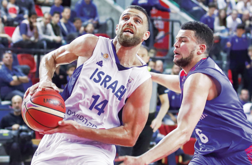 Israel guard Raviv Limonad drives to the basket to score two of his 15 points during Friday's 82-75 victory over Great Britain in Tel Aviv (photo credit: DANNY MARON)