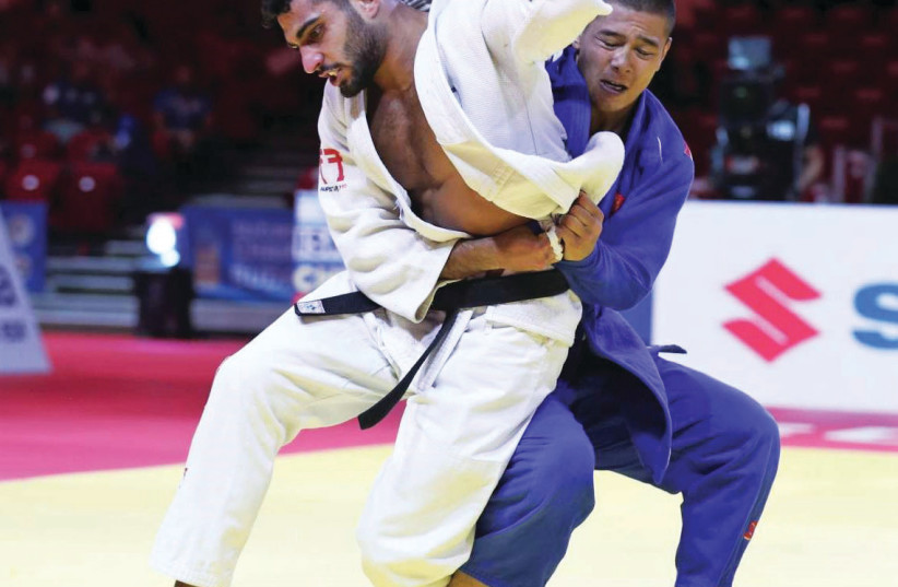 Israeli judoka Tohar Butbul (in white). (photo credit: INTERNATIONAL JUDO FEDERATION/COURTESY)