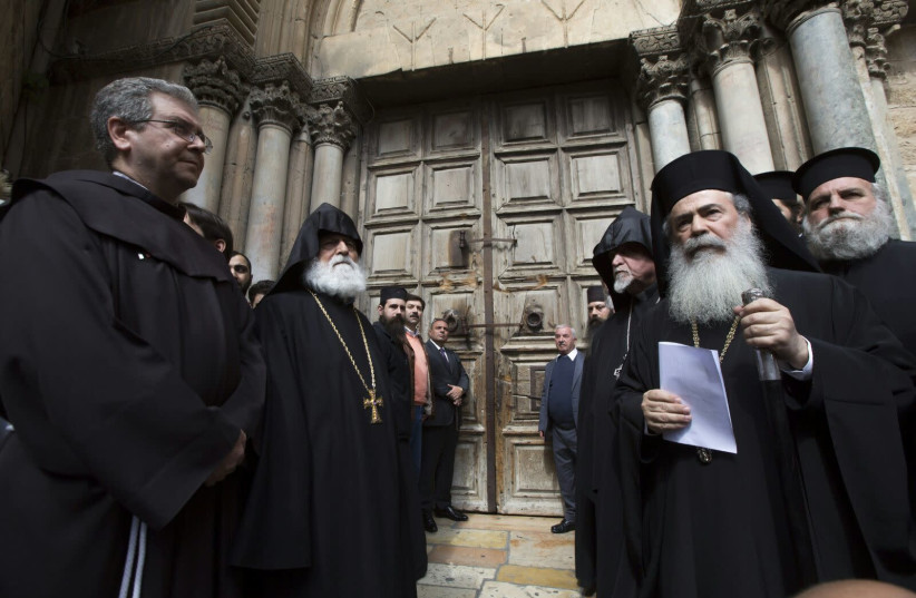 Jerusalem heads of churches in front of the Church of the Holy Sepulchre, which closed over municipality's tax demands on February 25th, 2018. (photo credit: MAB-CTS)