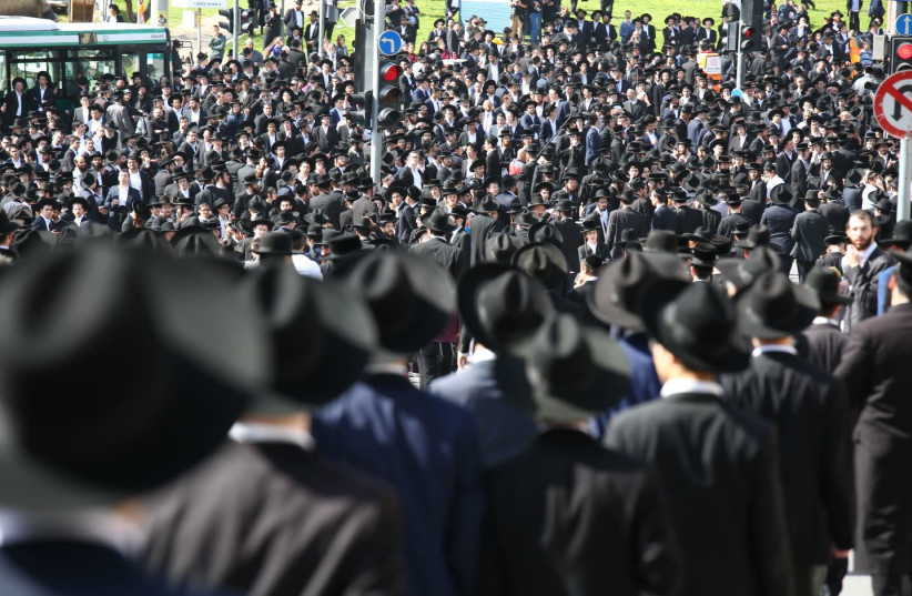Haredi men gather in Jerusalem for the funeral of Rabbi Shmuel Auerbach  (photo credit: EHUD AMITON/TPS)