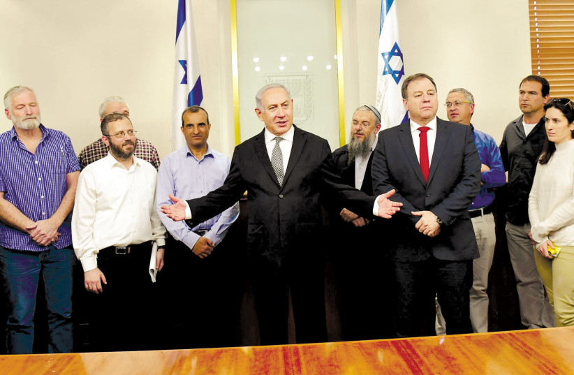 Prime Minister Benjamin Netanyahu meets with settler leaders after a cabinet vote legalizing the Netiv Ha'avot outpost, February 2018 (photo credit: AMOS BEN-GERSHOM/GPO)
