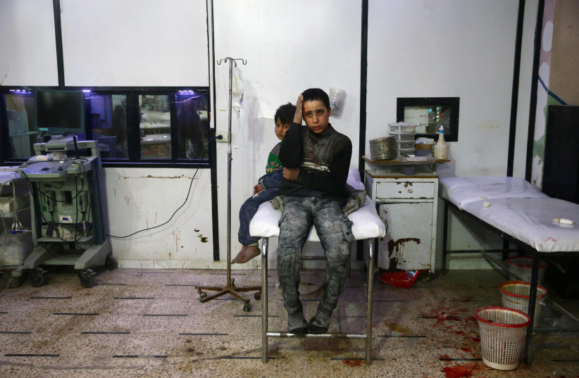 Wounded children in a hospital in the besieged town of Douma, Eastern Ghouta, Damascus, Syria (photo credit: REUTERS/BASSAM KHABIEH)