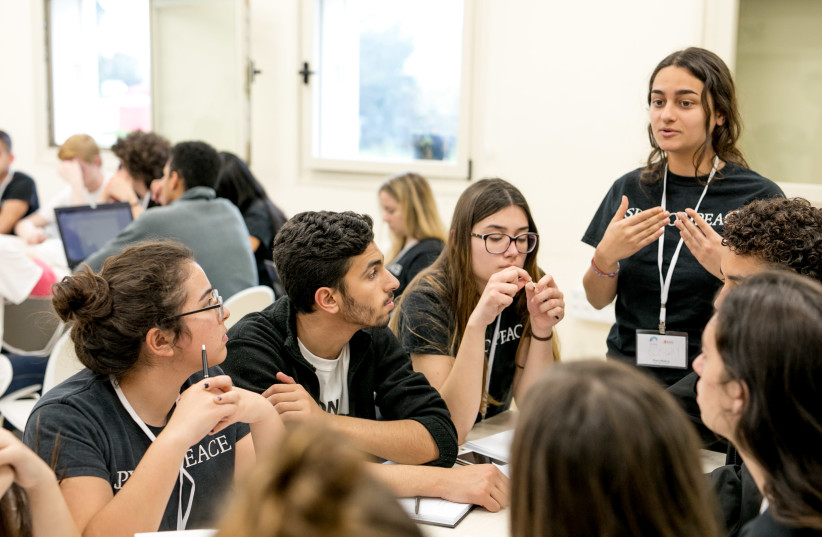 More than 70 11th grade students from 17 countries at the Eastern Mediterranean International Boarding School reached a peace agreement in a 24-hour simulation of Israeli-Palestinian peace talks held the week of February 21-22 2018 at the Charney Resolution Center. (Illustrative)) (photo credit: IFAT GOLAN)